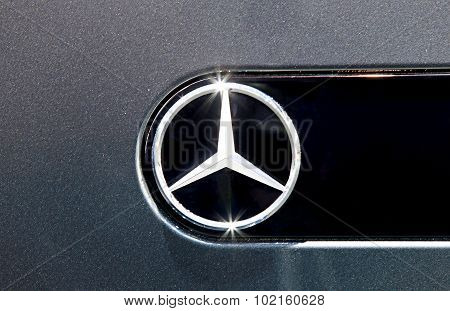 Close Up Logo Of Mercedes Benz On Black Car