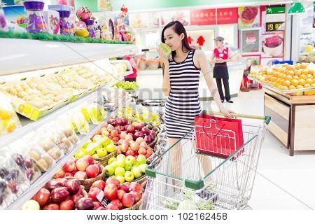 Girl Fruit In The Supermarket