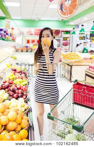 Chinese Girl In The Selection Of Fruit