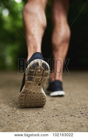 Shoe Sole Of A Man Running At The Park