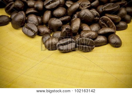 Roasted Coffee Beans Background Texture On Wooden Background.