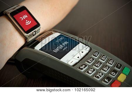 Man Making Payment Through Smartwatch Via Nfc Technology