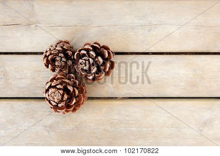 Pine Cones On Wood Board