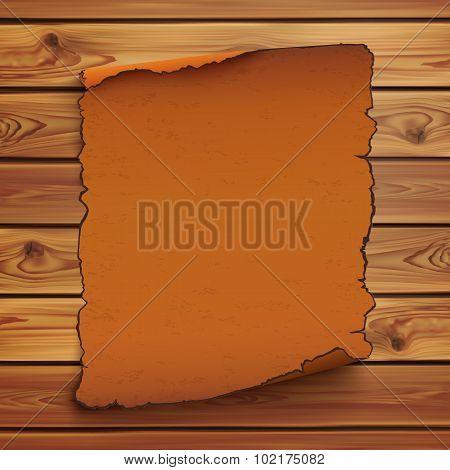 Old, orange scroll on wooden planks.