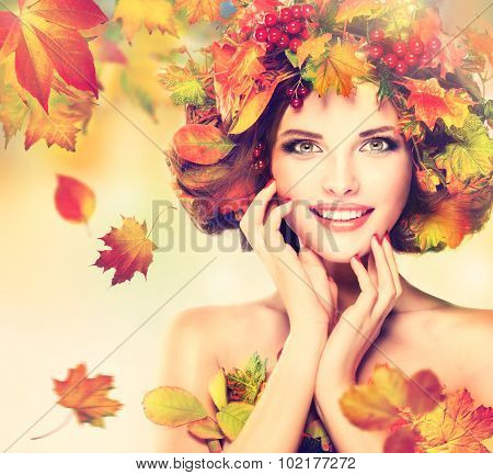 Autumn Beauty - fashion Makeup With Red and yellow autumn Leaves. Autumn wreath . Emot