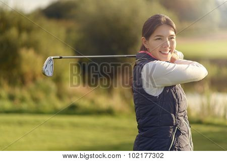Smiling Friendly Young Woman Golfer