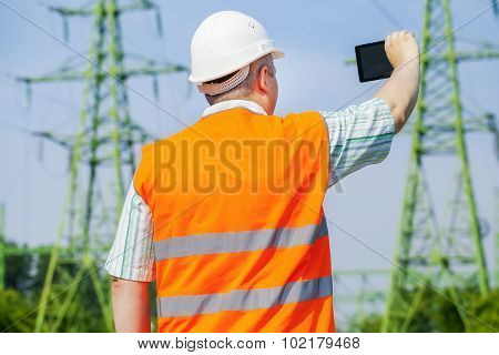 Electrical engineer near high voltage power line