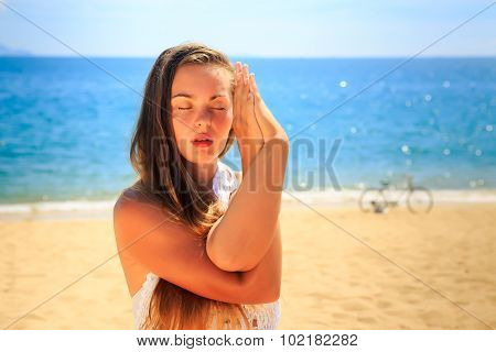 Blonde Girl In Lace Costume Closed Eyes In Yoga Asana Interlaces Hands