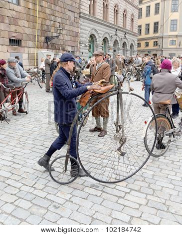 Man Leading An Very Old Bicycle And Wearing Old Fashioned Tweed Clothes
