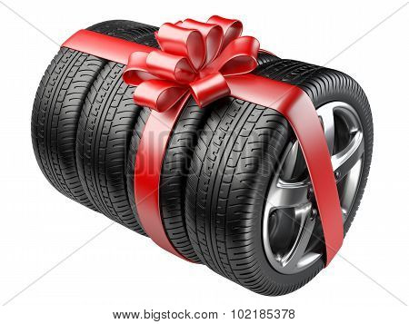 Gift Set Tyres With A Wrapped Red Ribbon And Bow.