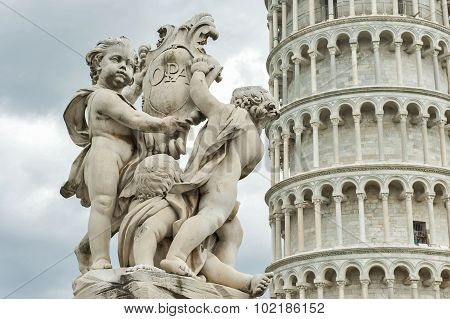 Angels Statue and Leaning tower of Pisa, Italy