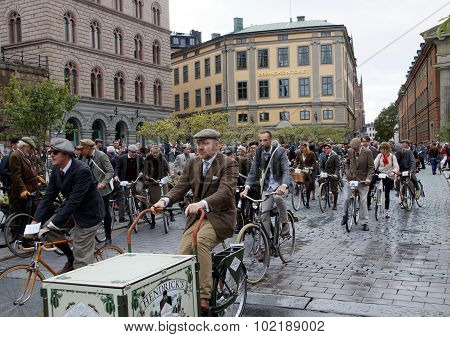 Group Of Elegant Cycling People Wearing Old Fashioned Tweed Clothes