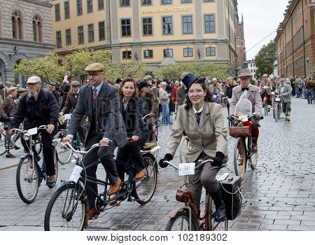 Group Of Cycling People Wearing Old Fashioned Tweed Clothes
