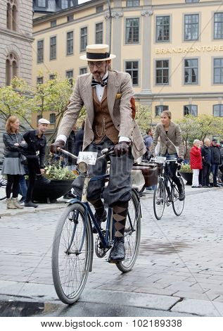 Elegant Cycling Man Wearing Old Fashioned Tweed Clothes