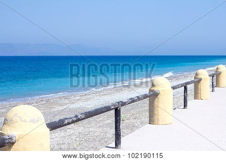 the promenade and the blue sea on a sunny day