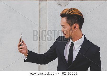 Young Handsome Asian Model Taking A Selfie