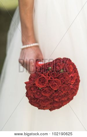 The Bride's Bouquet Of Red Roses