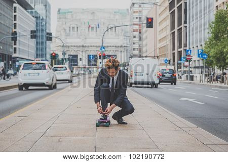 Young Handsome Asian Model Posing On His Skateboard