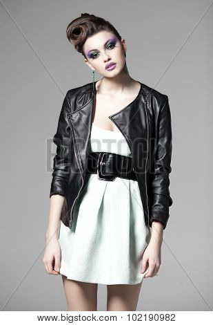 Beautiful Woman Posing In A Black Leather Jacket