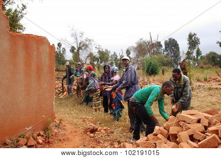 The Recovery Of The Bricks Still Good To A House Collapsed, Pomerini, Tanzania, Africa