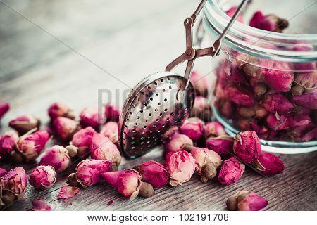 Rose Buds Tea, Tea Infuser And Glass Jar. Selective Focus.