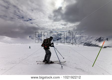 Skier On Ski Slope Before Storm