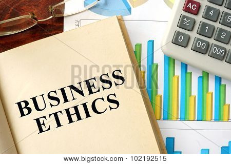 Word business ethics written on a book.