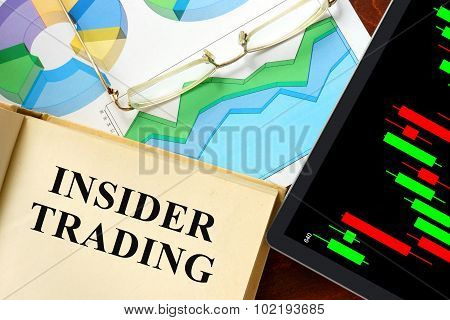 Word insider trading written on a book.