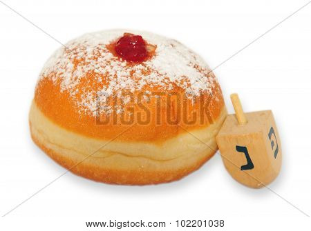 Sufganiyah, a round jelly doughnut eaten in Israel and around the world on the Jewish festival of Hanukkah.