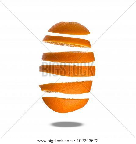 Falling slices of orange in air isolated on white