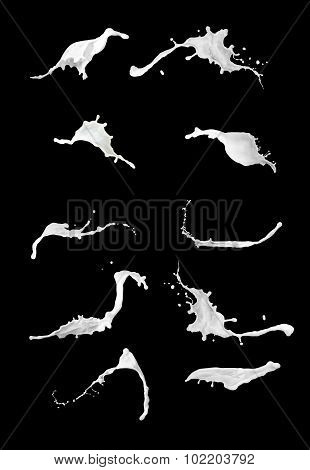 Milk splashes collection, isolated on black background