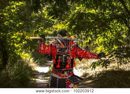 Samurai In Ancient Armor, With A Sword Ready To Attack