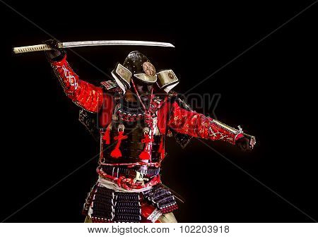 Samurai In Ancient Armor With A Sword Attack