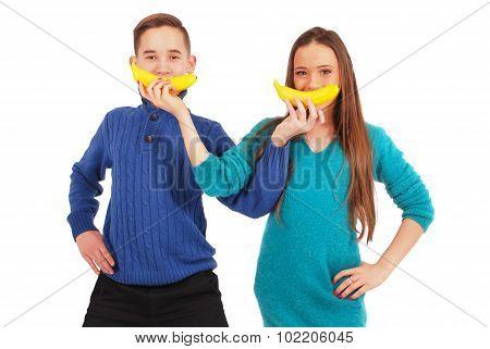 Boy And Girl Holding Bananas