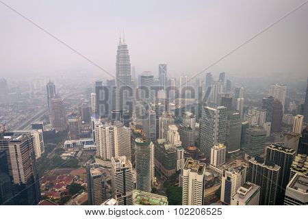 KUALA LUMPUR - SEPTEMBER 15, 2015: Smoke from forest fires in Sumatra blows across the Malay Peninsula causing haze in Kuala Lumpur City Center.
