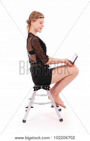 Girl Looking At Tablet Pc While Sitting On The Stairs