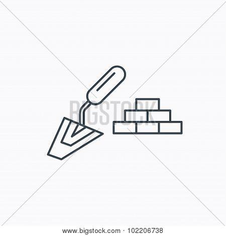 Finishing icon. Spatula with bricks sign.