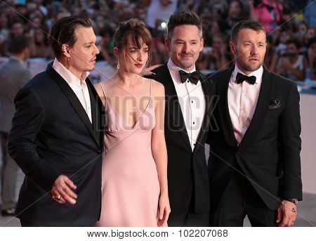 Scott Cooper, Johnny Depp, Dakota Johnson, Joel Edgerton at the premiere of Black Mess at the 2015 Venice Film Festival. September 4, 2015  Venice, Italy