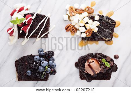 Chocolate loaf cake slices on a marble board