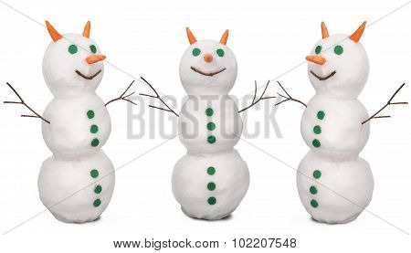 Three White Snowman Whith Green Buttons And Carrot