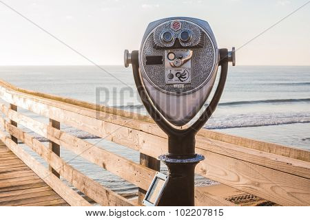 Close-Up of Sightseeing Binoculars on Pier