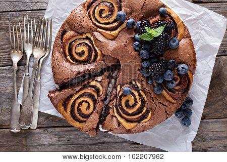 Chocolate cake with rolls inside