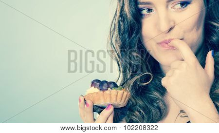 Smiling Cute Woman Holds Fruit Cake In Hand