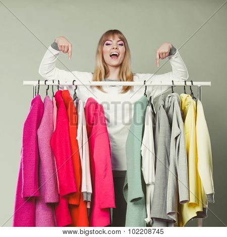Woman Pointing At Clothes In Mall Or Wardrobe.