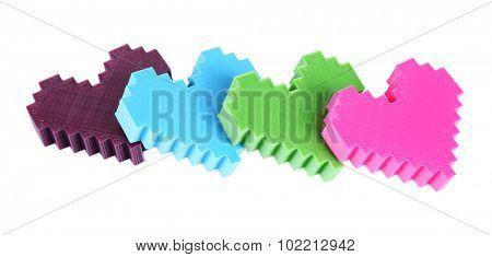 Plastic puzzle hearts isolated on white