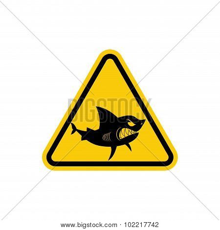 Sign Of Attention To  Sharks. Yellow Warning Sign For Ocean. Swimming Is Prohibited In  Waters Inhab