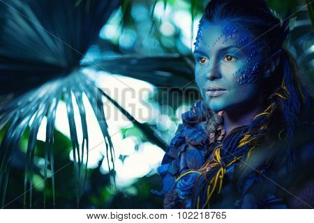 Blue woman creature in a magical forest