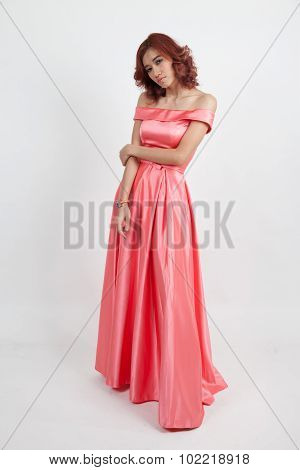 Portrait Of A Beautiful Girl In A Red Dress Isolated On Overwhite Background