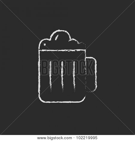 Mug of beer hand drawn in chalk on a blackboard vector white icon isolated on a black background.