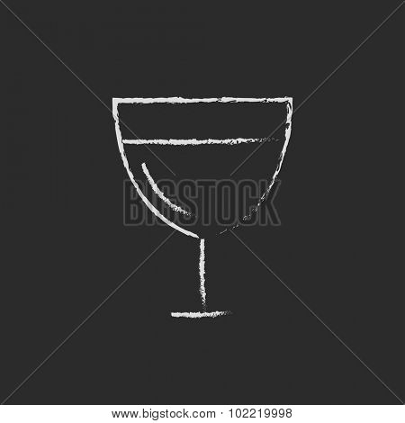Glass of wine hand drawn in chalk on a blackboard vector white icon isolated on a black background.